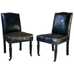 Pair of French Black Leather Upholstered and Ebonized Library Chairs, circa 1880