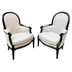 Pair of French Black Painted Louis XVI Styler Bergère Armchairs