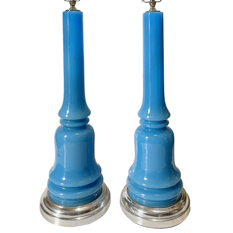 Pair of circa 1950s French blue glass table lamps with nickel-plated bases.  Measurements: Height 22