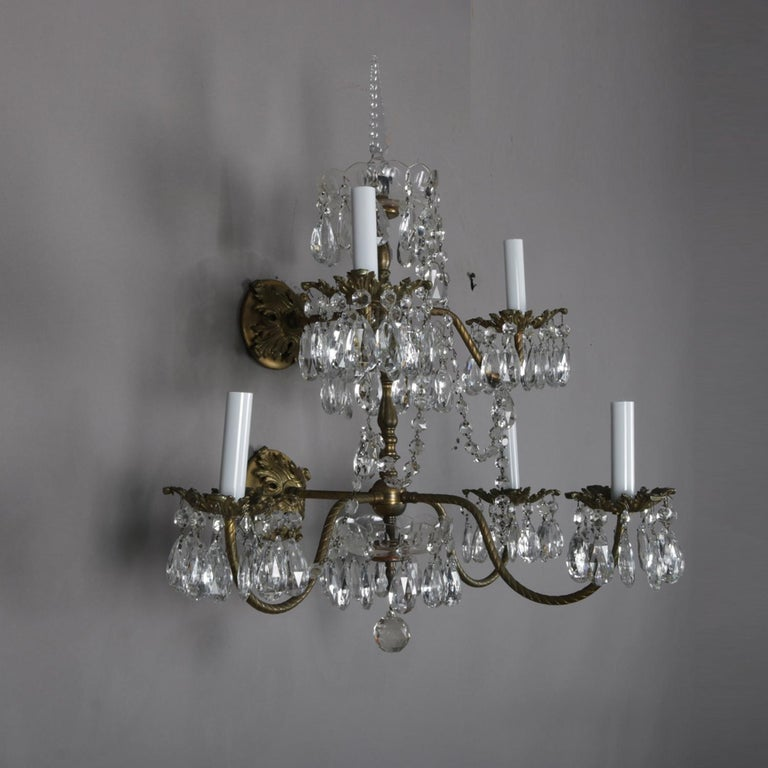 A pair of French electric wall sconces feature two tier brass branch chandelier form each with five candle lights and highlighted with hanging rock cut crystals, 20th century
