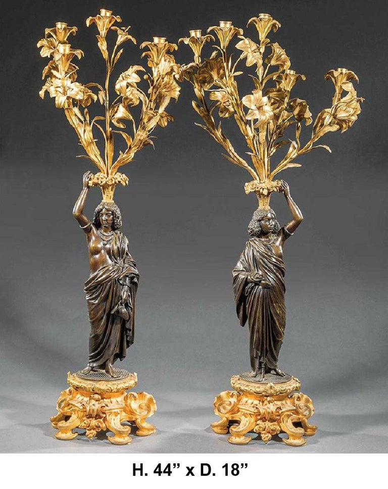 Monumental 19th century French Louis XV style ormolu and patinated bronze figural five-light candelabra. The exceptionally patinated neoclassical maiden in draped Classical robes standing and holding an ormolu floral bouquet five-light candelabra