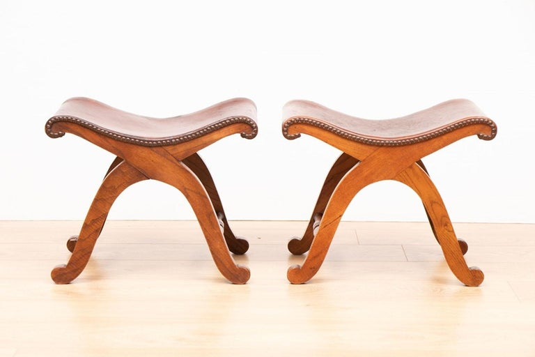 Pair of French brown leather stools by Pierre Lottier for Valenti circa 1940  Pierre Lottier's earliest success was as a restaurateur along the Cote D'Azur catering to the aristocratic and glamorous crowd during the wars. He later moved to