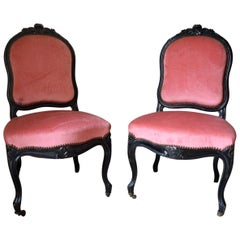 Pair of French Carved Ebonized Napoléon III Chairs, 1880s