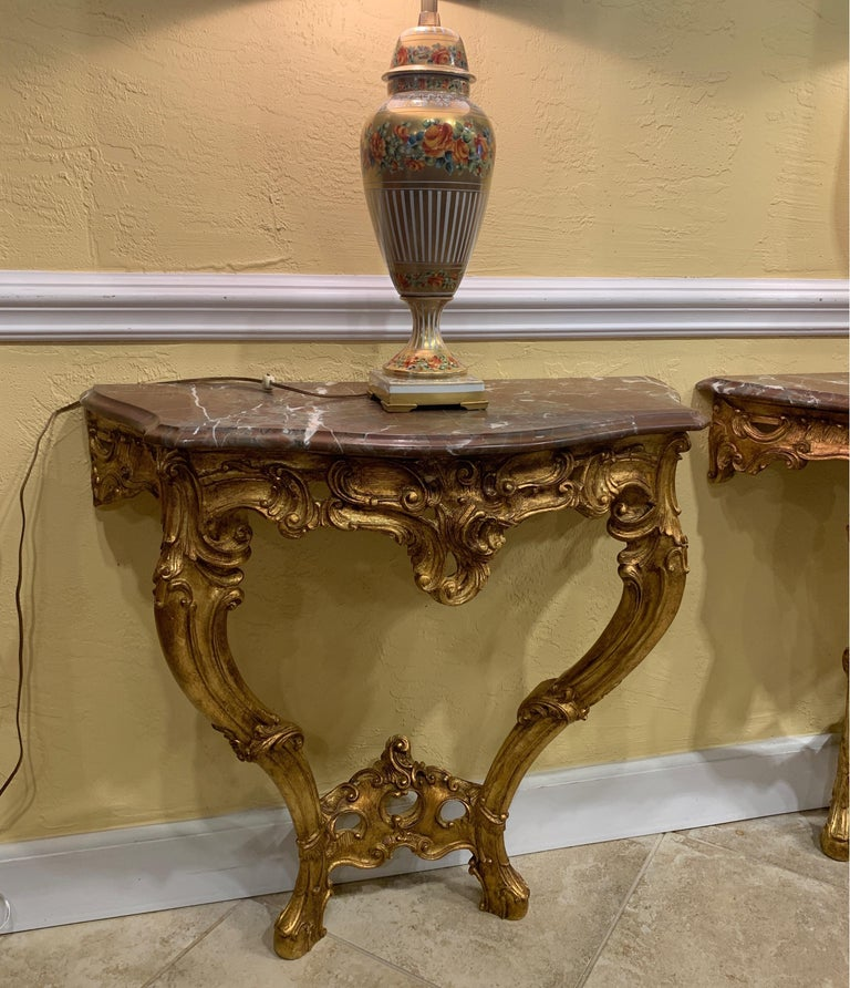 Pair of French Carved and Gilt Rococo Style Marble Top Consoles In Good Condition For Sale In Ft. Lauderdale, FL