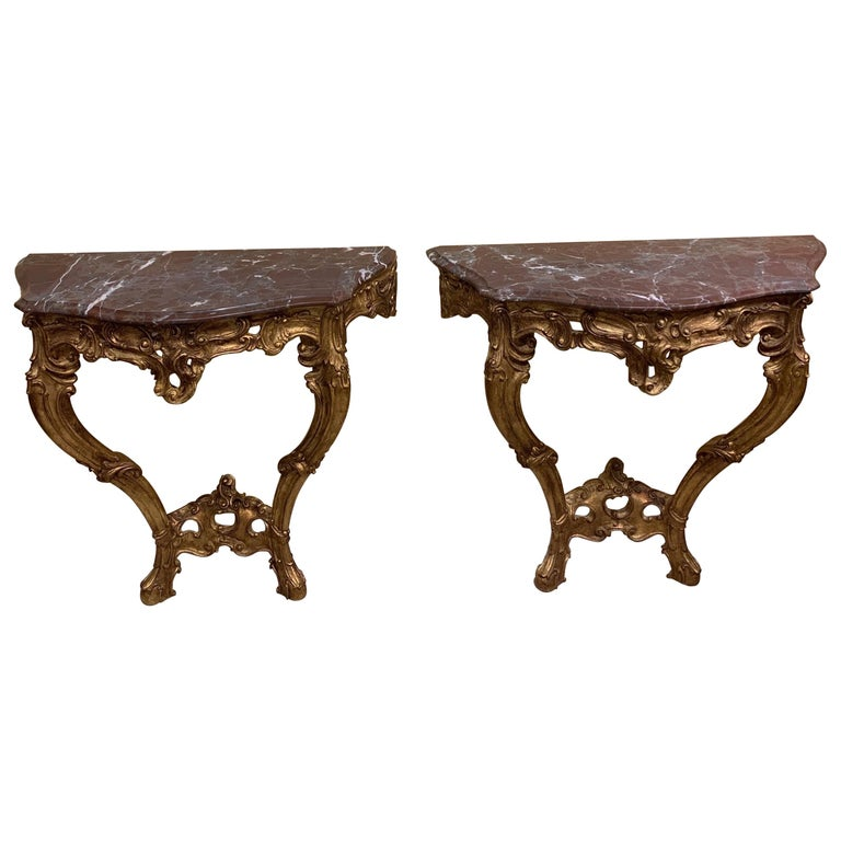 Pair of French Carved and Gilt Rococo Style Marble Top Consoles For Sale