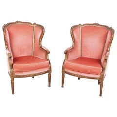 Pair of French Carved Gilt Wingback Chairs