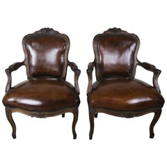 Pair of French Carved Leather Upholstered Armchairs