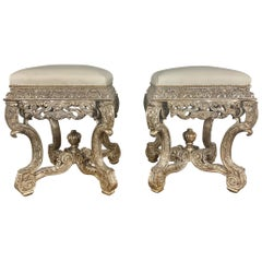 Pair of French Carved Silver Gilt and Leather Benches
