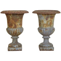 Pair of French Cast Iron and Parcel Painted Campana Form Urns Early 20th Century