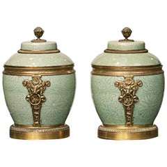 Pair of French Celadon Porcelain Lided Vases