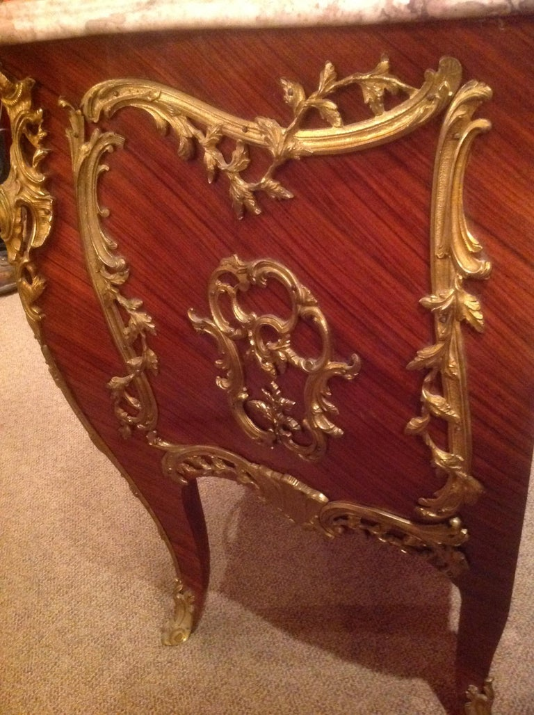 Veneer Pair of French Commodes Bombe' Form with Elaborate Bronze Mounts For Sale
