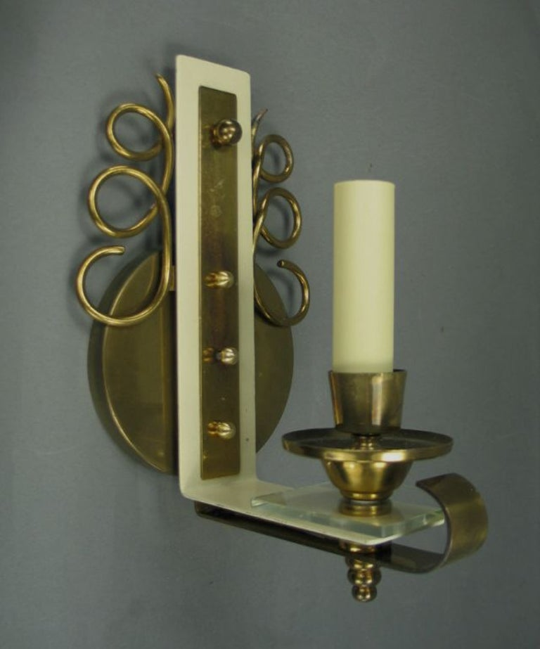 Pair of brass and glass French sconces.
