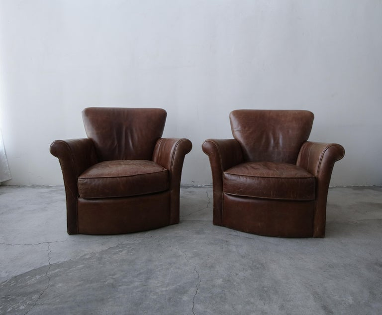 A beautiful pair of properly patinaed leather club chairs. This pair is the epitome of perfect worn leather chairs. Chairs feature the kind of patina that money can't buy, the kind that only comes with use over years. If you've been looking for a