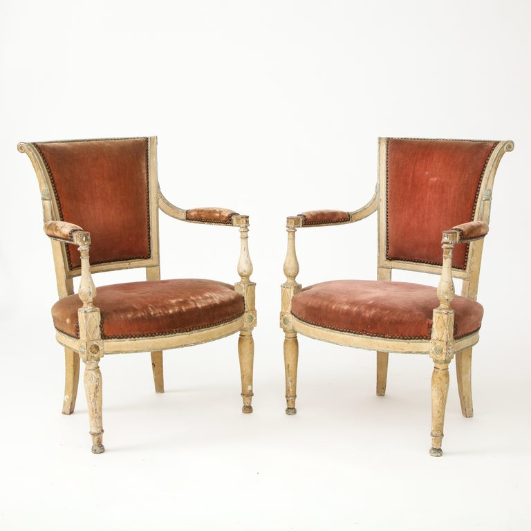 Handsome pair of Directoire style chairs. Marked by interesting details and heavy patina. 