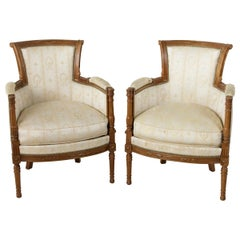 Pair of French Directoire Style Walnut Bergères or Armchairs, circa 1900