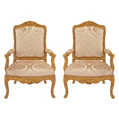 Pair of French Early 19th Century Louis XV St. Giltwood Armchairs