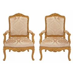 Pair of French Early 19th Century Louis XV Style Giltwood Armchairs