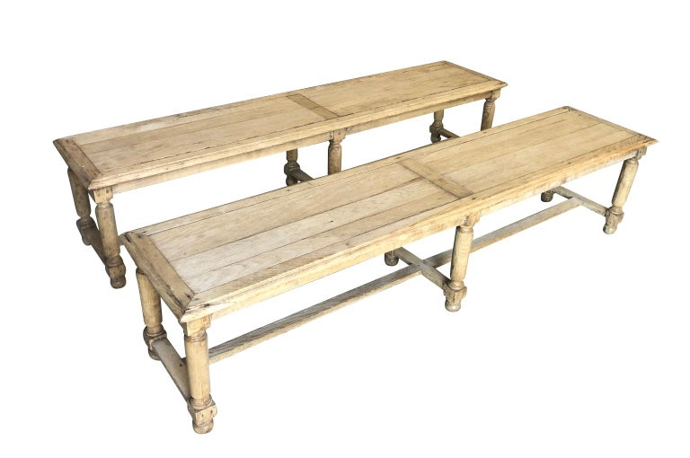 A very handsome pair of early 20th century benches from the South of France. Sturdily constructed from washed oak. Wonderful seating to accompany a large farm table.