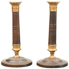Pair of French Empire Candlesticks in Gilt and Burnished Bronze