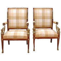 Pair of French Empire Fauteuils in Mahogany with Bronze Doré Ormolu, circa 1810