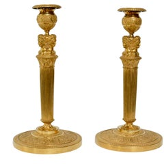 Pair of French Empire Gilt Bronze Candlesticks