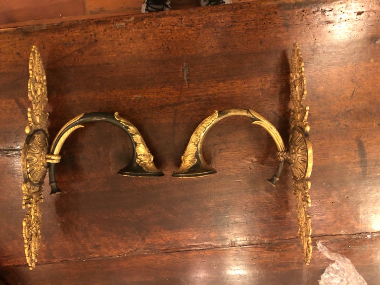 Pair of French Empire gilt bronze wall sconces with north wind motif.