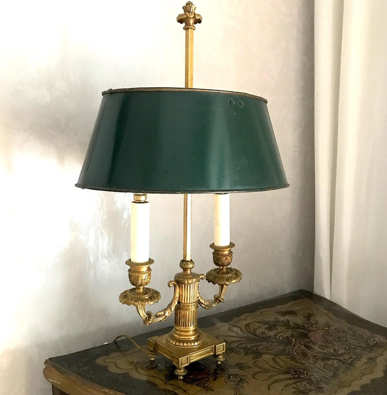 Elegant Empire gilded bronze finely chiseled Bouillotte lamps with dark green painted tole adjustable shade. Two E 14 light bulbs. We can deliver wired for US standard.