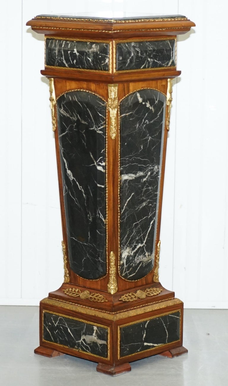 We are delighted to offer for sale this stunning pair of French Empire style heavy marble column pedestals with kingwood veneer and ormolu mounts.  A very good looking, decorative and heavy pair of marble columns, designed to seat busts, statues