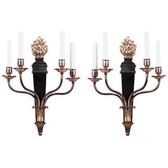 Pair of French Empire Style Ebonized and Gilt Four-Arm Wall Sconces