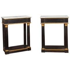 Pair of French Empire Style Ebonized Console Tables with Gilt Accents and Marble