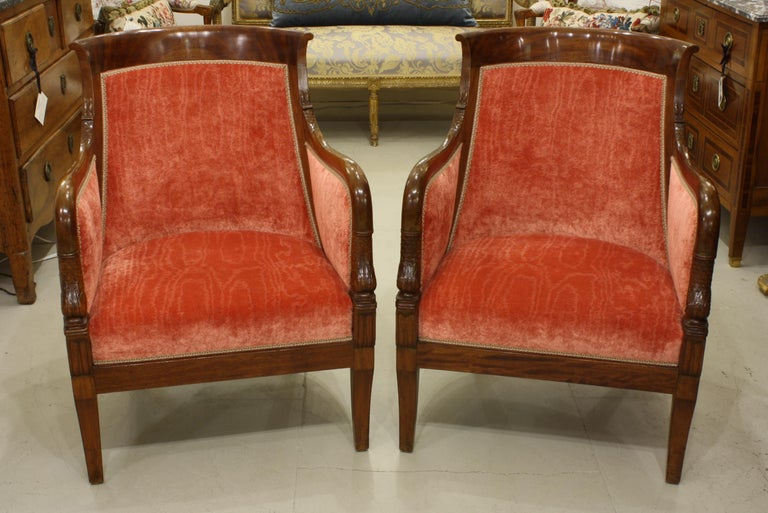 Veneer Pair of French Empire Style Mahogany Bergere Armchairs with Dolphins For Sale