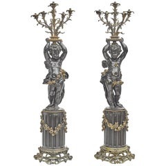 Pair of French Gilt and Patinated Bronze Figural Torchieres
