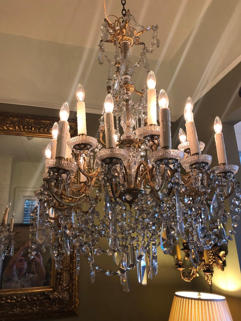 Pair of French gilt bronze and Baccarat crystal chandeliers with 18 lights each. Rewired. Baccarat crystals on gilt bronze armature.