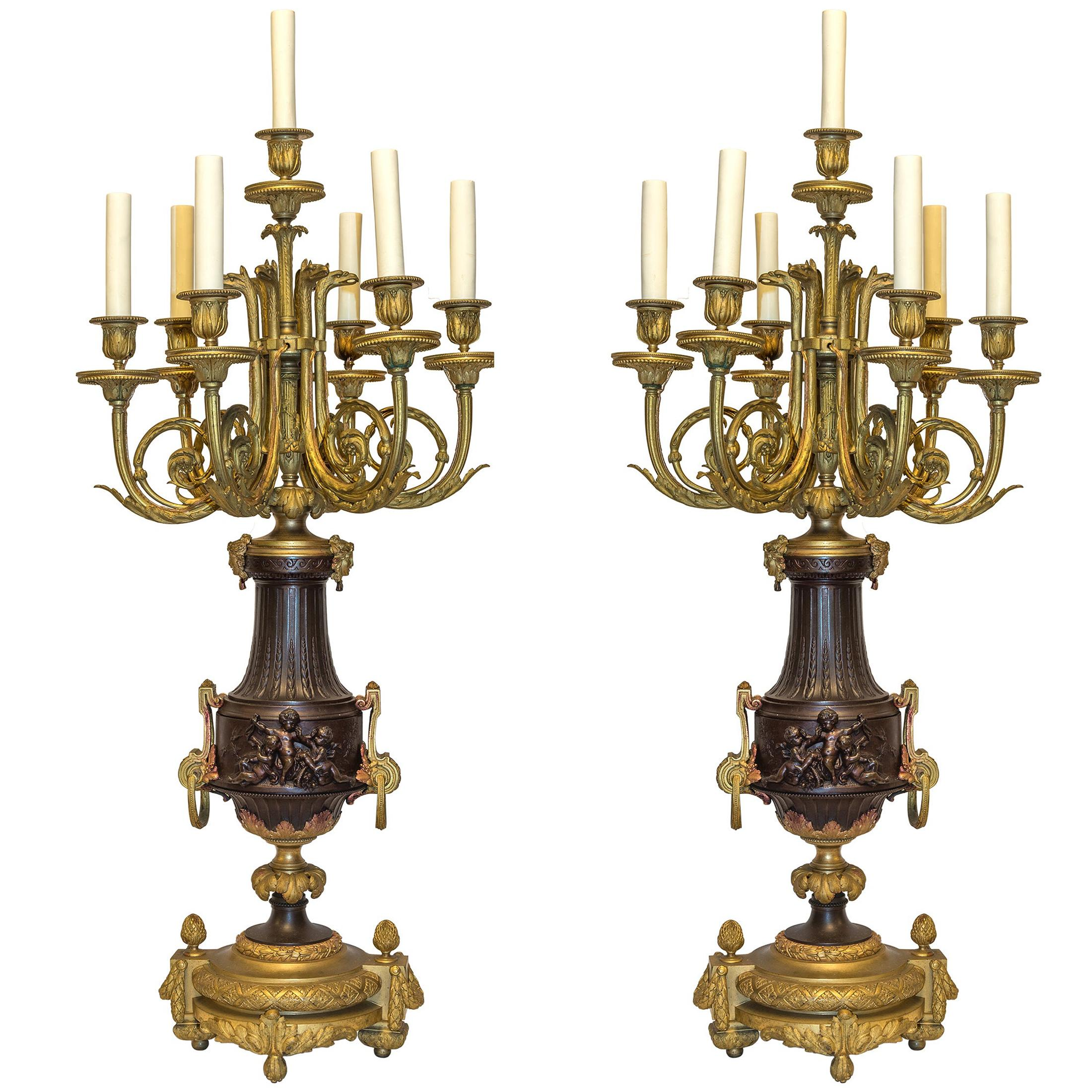 Pair of French Gilt Bronze and Patinated Bronze Seven-Light Figural Candelabra