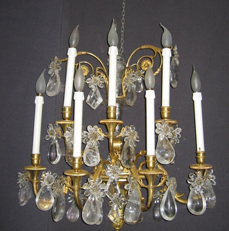 Magnificent pair of French gilded bronze seven branch wall lights with rock crystal drops. Seven scrolled finely chiseled arms on two levels. Available three pairs. Provenance from an Aristocratic Roman Palace.  Measurements: cm 80 x 70 x
