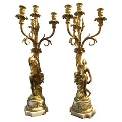 Pair of French Gilt Bronze Figural Candelabra circa 1790 on White Marble Bases