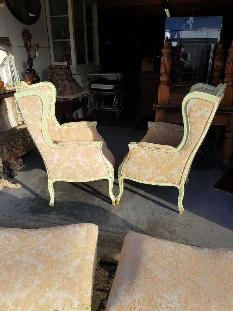 Pair of French Green Painted Wingback Chairs with Footstools, Late 20th Century For Sale 1