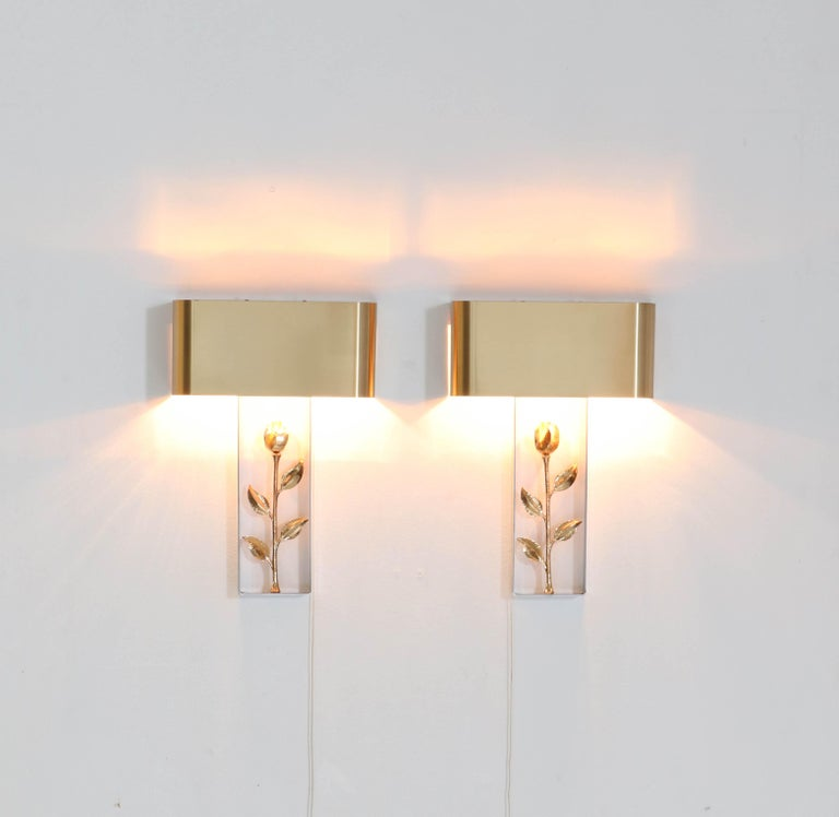 Magnificent and rare pair of Hollywood Regency wall lights or sconces. Design by Maison Charles Paris. Polished steel frame with bronze lacquered shade and flower. Two light fittings each. In very good condition with a beautiful patina.