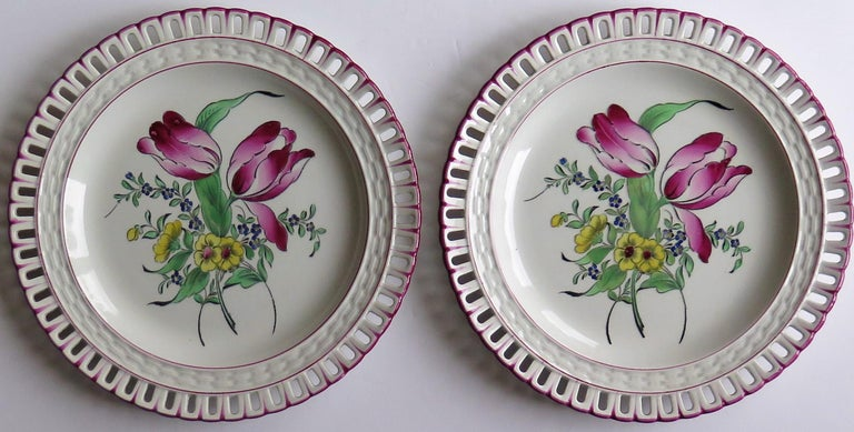 These are a beautiful pair of French Faience dinner plates with pierced rims, made by the Luneville K&G factory and dating to the late 19th century, circa 1895.