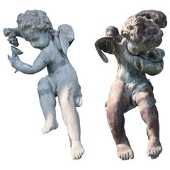 Pair of French Lead Bacchus Cherub Seated Garden Figures