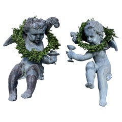 Pair of French Lead Bacchus Putti Seated Garden Figures