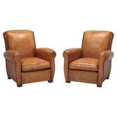 Pair of French Leather Club Chairs Fully Restored in Our Upholstery Department