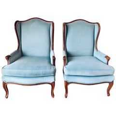 Pair of French Louis XV Blue Upholstered Carved Wingback Chairs