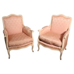 Pair of French Louis XV Crème Painted Bergère Lounge Chairs with Pink Damask