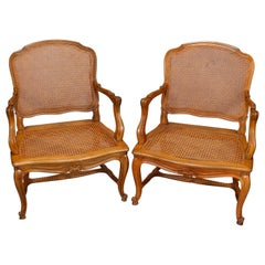 Pair of French Louis XV Fruitwood Pressed Cane Arm Chairs, 19th Century