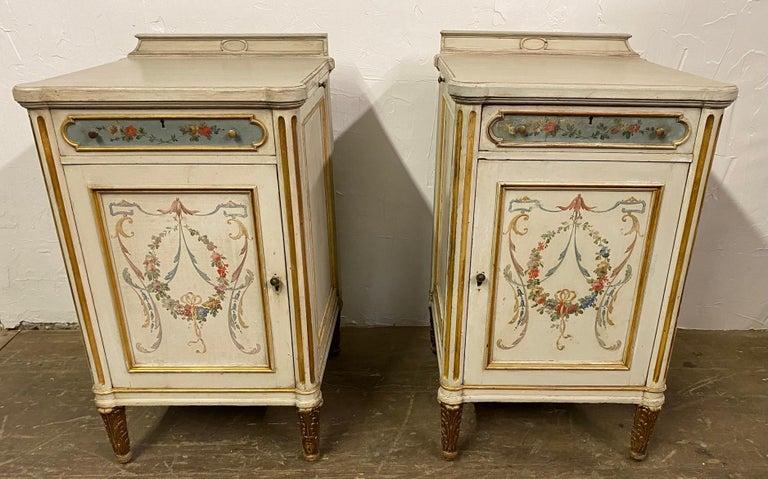 Pair of vintage French Louis XV paint decorated night stands. These stands were once part of a dresser or vanity. The middle section had been removed to make into two night stands thus the two sides of each of the two stands are slightly