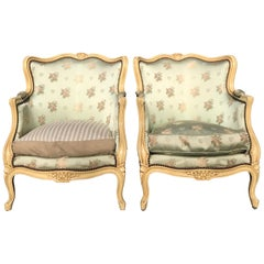 Pair of French Louis XV Painted Bergere Chairs with Beautifully Carved Flowers