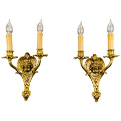 Pair of French Louis XV Style Bronze Cherubs Head Twin Arm Wall Sconces