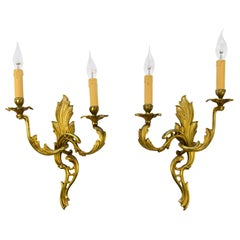 Pair of French Louis XV Style Two-Light Bronze Sconces