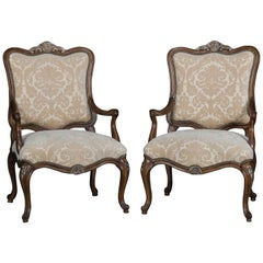 Pair of French Louis XV Style Carved and Gilt Mahogany Fauteuil Chairs